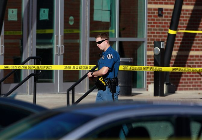 Secured: Action by the Arapahoe County Sheriff's Department in Colorado ended a school shooting Friday in 80 seconds, when an armed deputy closed in on the gunman. (Associated press)