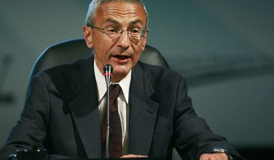** FILE ** John Podesta, president and CEO of the Center for American Progress Action Fund, speaks at the National Clean Energy Summit 2.0 at the Cox Pavilion in Las Vegas in 2009. (AP Photo/Eric Jamison)