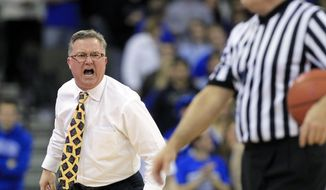 Southern Illinois head coach Barry Hinson, center, incurs a technical foul after yelling at referee Gerry Pollard, right, in the second half of an NCAA college basketball game against Creighton in Omaha, Neb., Tuesday, Feb. 19, 2013. Creighton won 59-45. (AP Photo/Nati Harnik)