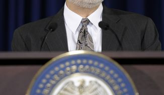 Federal Reserve Chairman Ben Bernanke speaks during a news conference at the Federal Reserve in Washington, Wednesday, Dec. 18, 2013. The Fed will begin to reduce bond purchases by $10 billion in January because of a stronger U.S. job market.(AP Photo/Susan Walsh)