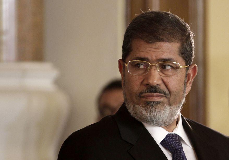 ** FILE ** Mohammed Morsi (AP Photo/Maya Alleruzzo, File)