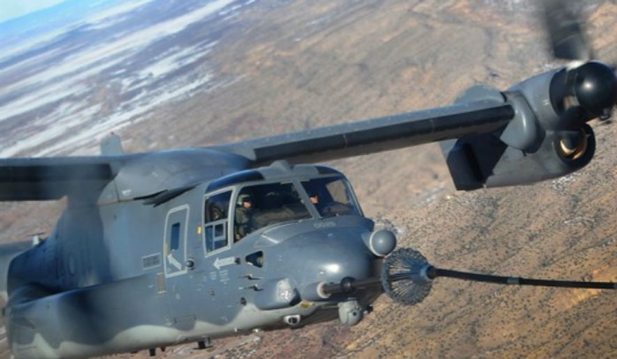 ** FILE ** A 71st Special Operations Squadron CV-22 Osprey receives fuel from a 522nd SOS MC-130J Combat Shadow II Jan. 4, 2012, over New Mexico. (U.S. Air Force)