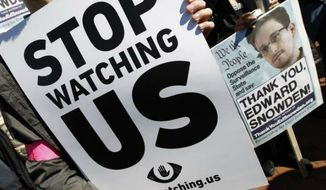 ** FILE ** An anti-spying protest takes place in the nation's capital on Oct. 26, 2013. (Jose Luis Magana / AP)