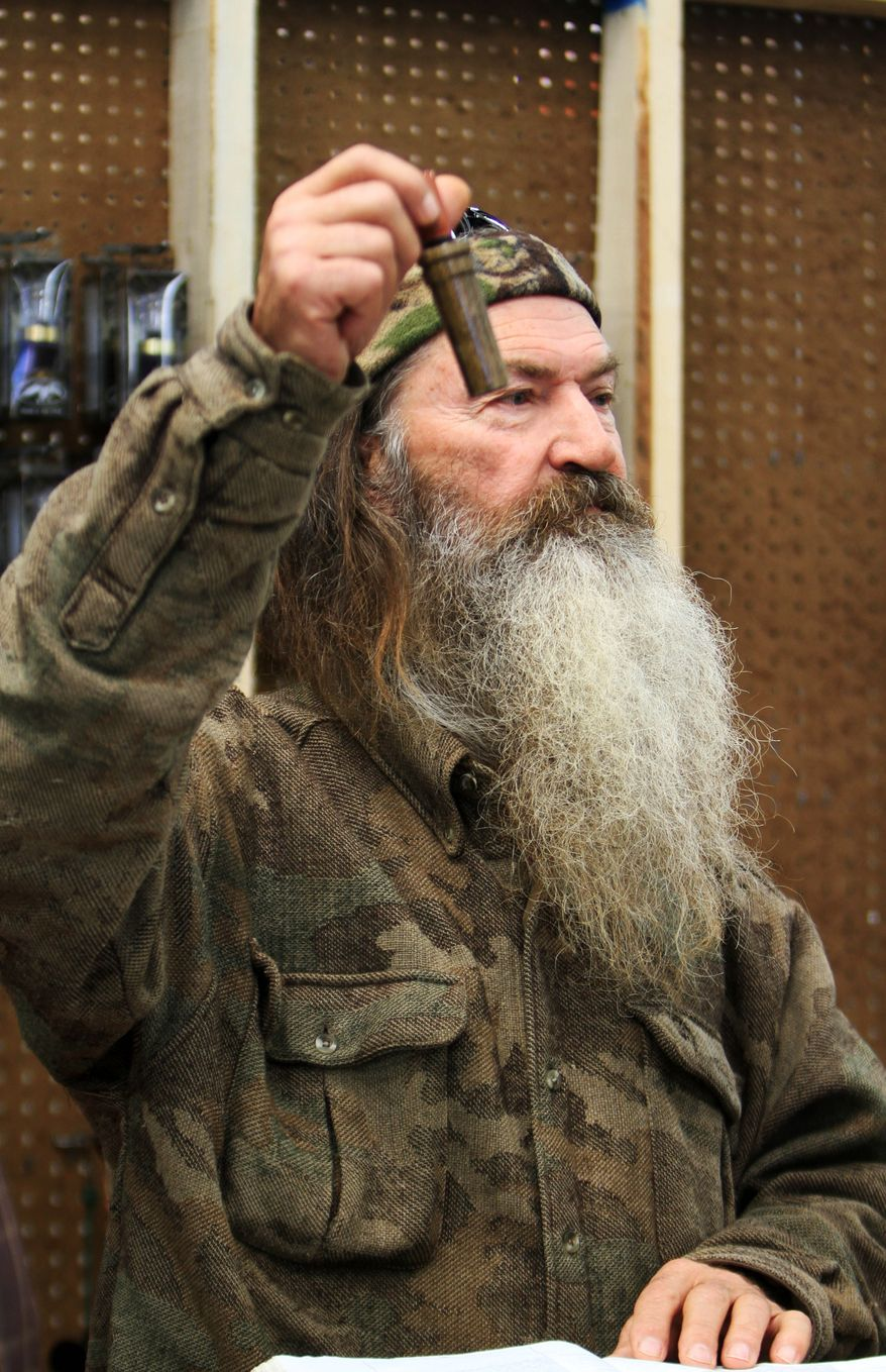 Phil Robertson, the Duck Commander, holding the 1 millionth duck call assembled for 2013 at his company's warehouse in West Monroe, La. (AP Photo, The News-Star/Margaret Croft)