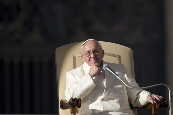 ** FILE ** Pope Francis smiles as he attends his weekly general audience in St. Peter's Square at the Vatican, Wednesday, Dec. 18, 2013. (AP Photo/Alessandra Tarantino)