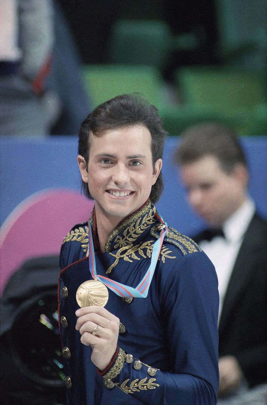 Brian Boitano of Sunnyvale, Calif., who won the men?s Olympic figure skating competition shows off his gold medal, Saturday, Feb. 20, 1988, Calgary, Canada. Boitano was the first American to capture the gold at the XV Winter Olympics. (AP Photo/Jack Smith)