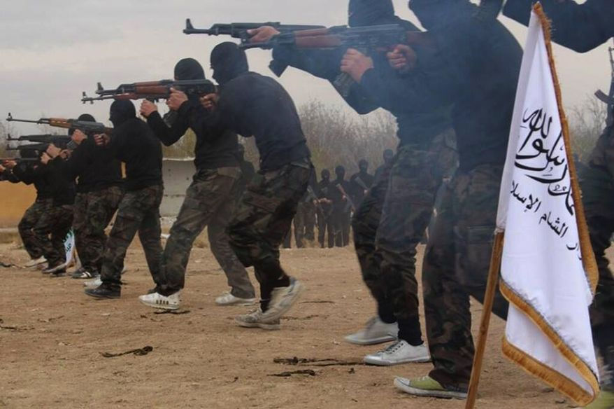 ** FILE **  Members of Ahrar al-Sham brigade, one of the Syrian rebels groups, exercise in a train camp at unknown place in Syria. The growing muscle of an al Qaeda linked Syrian group is casting a grim shadow over northern Syria, where extremist militants have turned their attention to seizing activists who cover their country. (AP Photo)