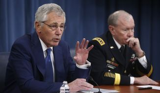 Defense Secretary Chuck Hagel and Chairman of the Joint Chiefs of Staff Gen. Martin Dempsey, brief reporters at the Pentagon in Washington, Thursday, Dec. 19, 2013. Hagel commented on the Congressional budget deal and took questions about Pakistan and Afghanistan from reporters. (AP Photo/Charles Dharapak)