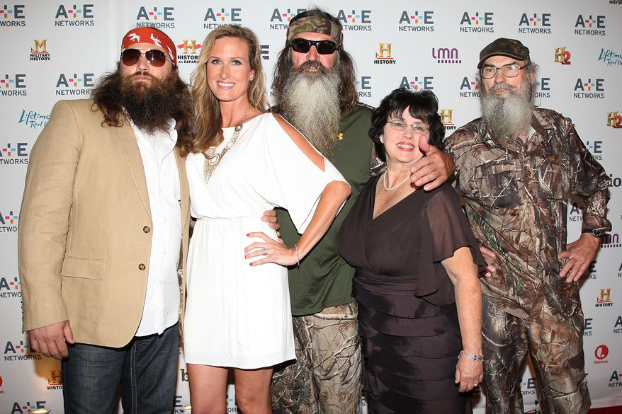 "In this May 9, 2012 photo, from left, Willie Robertson, Korie Robertson, Phil Robertson, Miss Kay Robertson and Si Robertson pose at the A&E Networks 2012 Upfront at Lincoln Center in New York. The Robertsons star in the A&E reality series ""Duck Dynasty."" (AP Photo/Starpix, Kristina Bumphrey)"