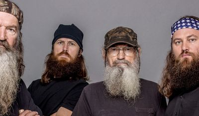 """This 2012 photo released by A&E shows, from left, Phil Robertson, Jase Robertson, Si Robertson and Willie Robertson from the A&E series, """"Duck Dynasty,"""" airing Wednesdays at 10 p.m. EST. (AP Photo/A&E, Zach Dilgard)"""