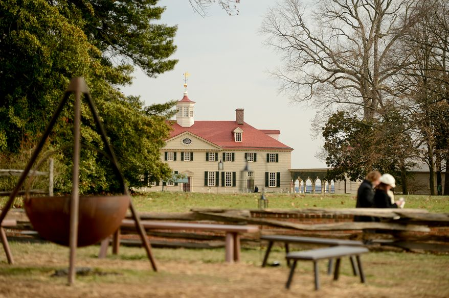 The Mount Vernon Mansion can be seen on the great lawn during Christmas at George Washington's Mount Vernon, Mount Vernon, Va., Monday, December 16, 2013. Mount Vernon celebrates Christmas with Christmas trees, 18th-century chocolate making, Christmas dancing and story telling, as well as Aladin the Camel. (Andrew Harnik/The Washington Times)