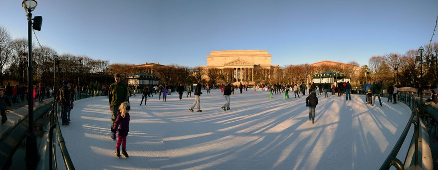 Skaters enjoy a slightly warmer Sunday afternoon at the Sculpture Garden Ice Rink - National Gallery of Art on the National Mall, Washington, D.C., Sunday, December 15, 2013. (Andrew Harnik/The Washington Times/Panoramic image, merge with multiple photographs)