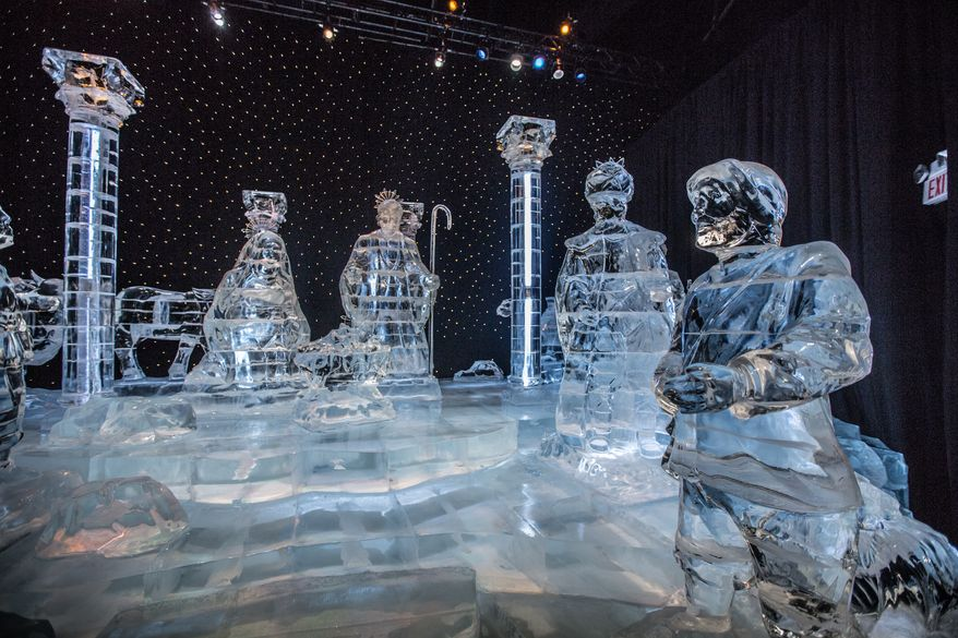 Giant clear pieces of sculpted ice depicting the Nativity Scene is on display at this years award winning ICE event and are carved by a team of 40 master ice artisans from Harbin, China, through January 5th at the National Harbor, in Fort Washington, MD., Friday, December 20, 2013.  (Andrew S Geraci/The Washington Times)