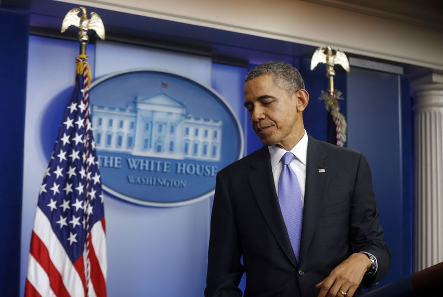 President Barack Obama leaves the podium after his end-of-the-year news conference in the Brady Press Room at the White House in Washington, Friday, Dec. 20, 2013. Obama is scheduled to depart later for his home state of Hawaii for his annual Christmas vacation trip. (AP Photo/Charles Dharapak)