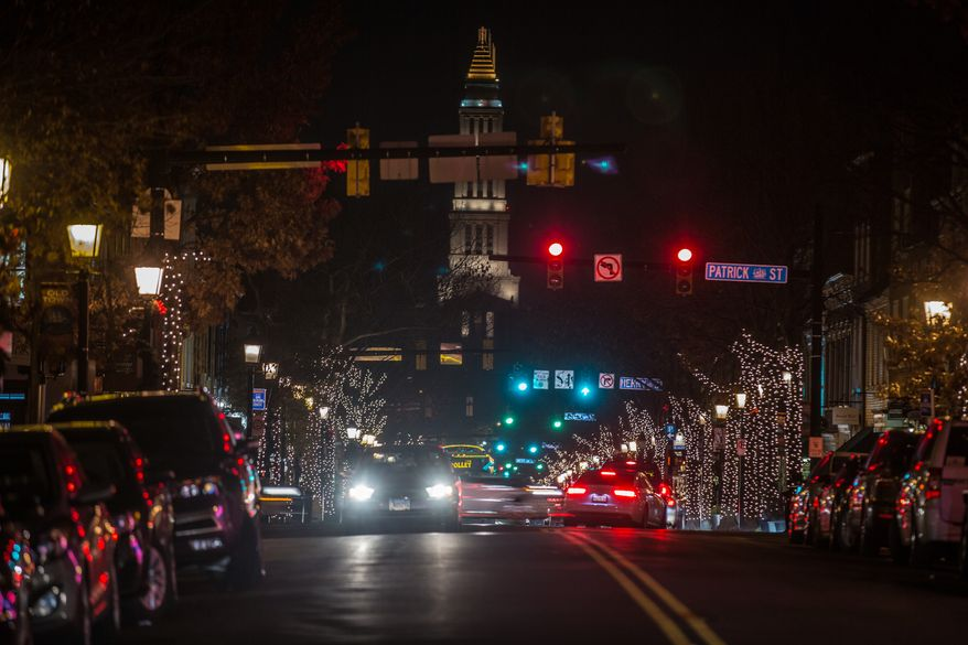 Christmas lights and decorations line the streets of Old Town, in Alexandria, VA., Wednesday, December 18, 2013.  (Andrew S Geraci/The Washington Times)