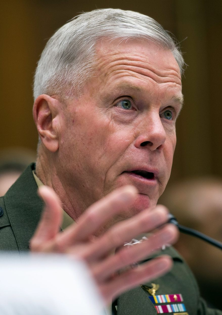 Higher-up: Marine Corps. Commandant Gen. James Amos is accused of retaliating against a major who said he was misusing his influence. (Associated Press)