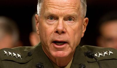 """Marine Corps Commandant Gen. James Amos ordered the officer overseeing a Taliban desecration case to """"crush"""" the defendants shown in a video, court-martial all of them and kick them out of the Corps, according to witnesses. (Associated Press)"""