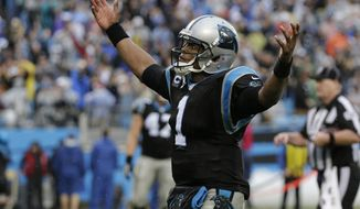 Carolina Panthers' Cam Newton (1) reacts after throwing a touchdown pass against the New Orleans Saints in the second half of an NFL football game in Charlotte, N.C., Sunday, Dec. 22, 2013. The Panthers won 17-13. (AP Photo/Chuck Burton)