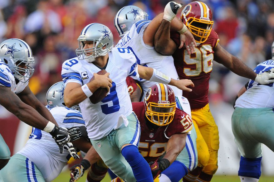 Cowboys quarterback Tony Romo scrambles to avoid the pursuit of Redskins linebacker Rob Jackson to keep a drive alive during the fourth quarter Sunday. (preston keres/special to the washington times)