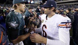 Chicago Bears' Jay Cutler, right, meets with Philadelphia Eagles' Nick Foles after an NFL football game, Sunday, Dec. 22, 2013, in Philadelphia. Philadelphia won 54-11. (AP Photo/Matt Rourke)