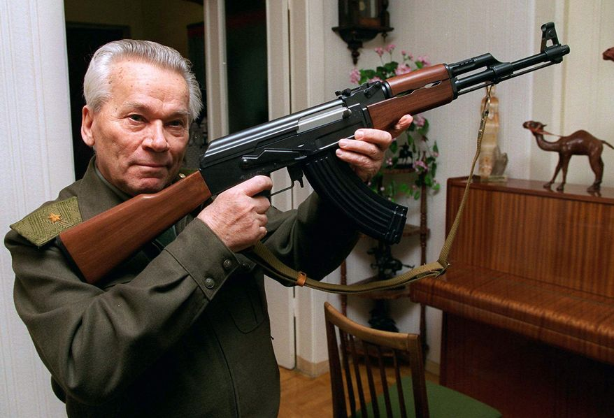 Man and machine: Gen. Mikhail Kalashnikov, whose work as a weapons designer for the Soviet Union is immortalized in the name of the world's most popular firearm, died Monday. (Associated Press)