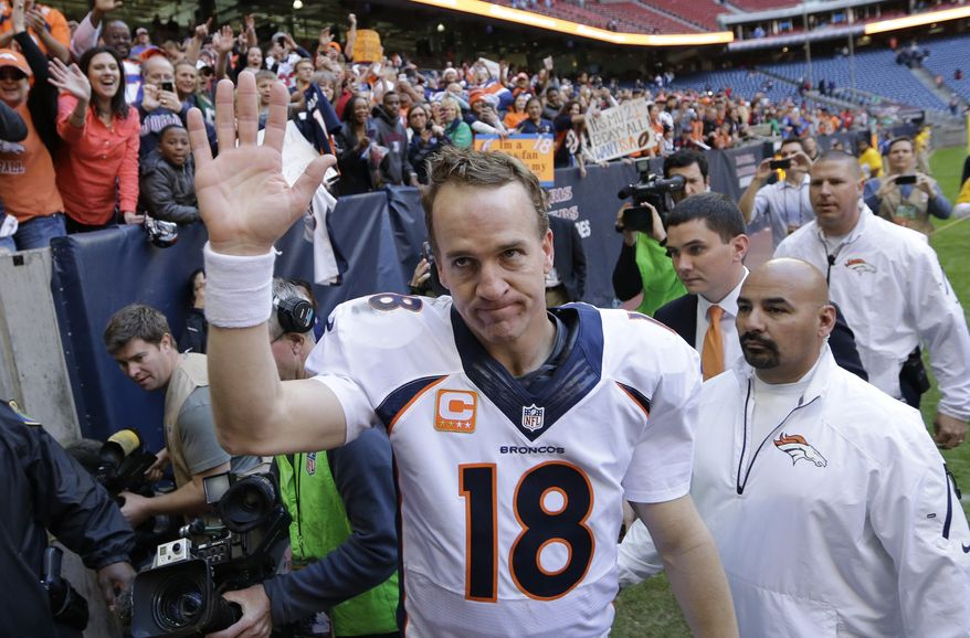 Denver Broncos' Peyton Manning (18) waves to fans following an NFL football game against the Houston Texans, Sunday, Dec. 22, 2013, in Houston. Manning threw his 51st touchdown pass of the season to set a new NFL record. (AP Photo/David J. Phillip)