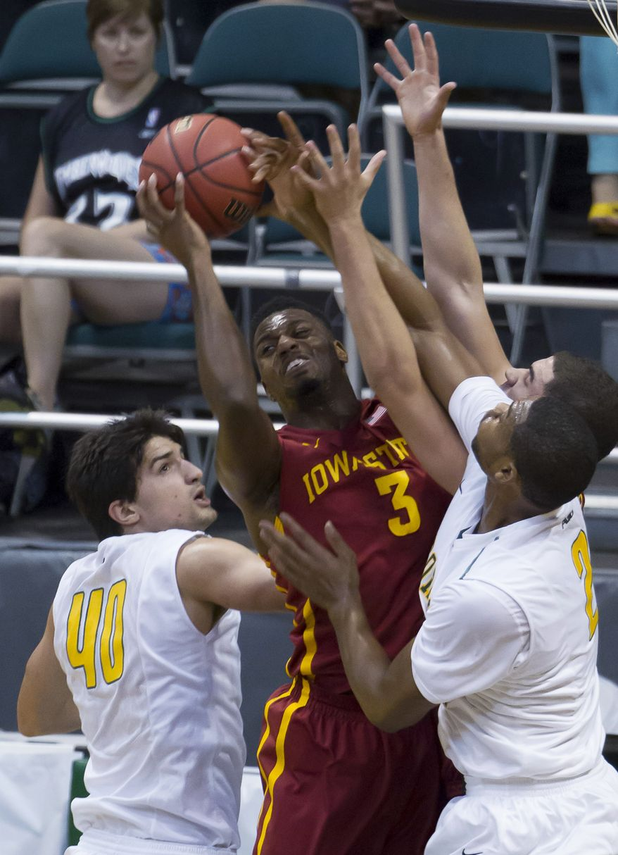 Iowa State forward Melvin Ejim (3) tries to George Mason forward Marko Gujanicic (40) and his teammate forward Johnny Williams (2) for a rebound in the first half of an NCAA college basketball game at the Diamond Head Classic on Sunday, Dec. 22, 2013, in Honolulu. (AP Photo/Eugene Tanner)