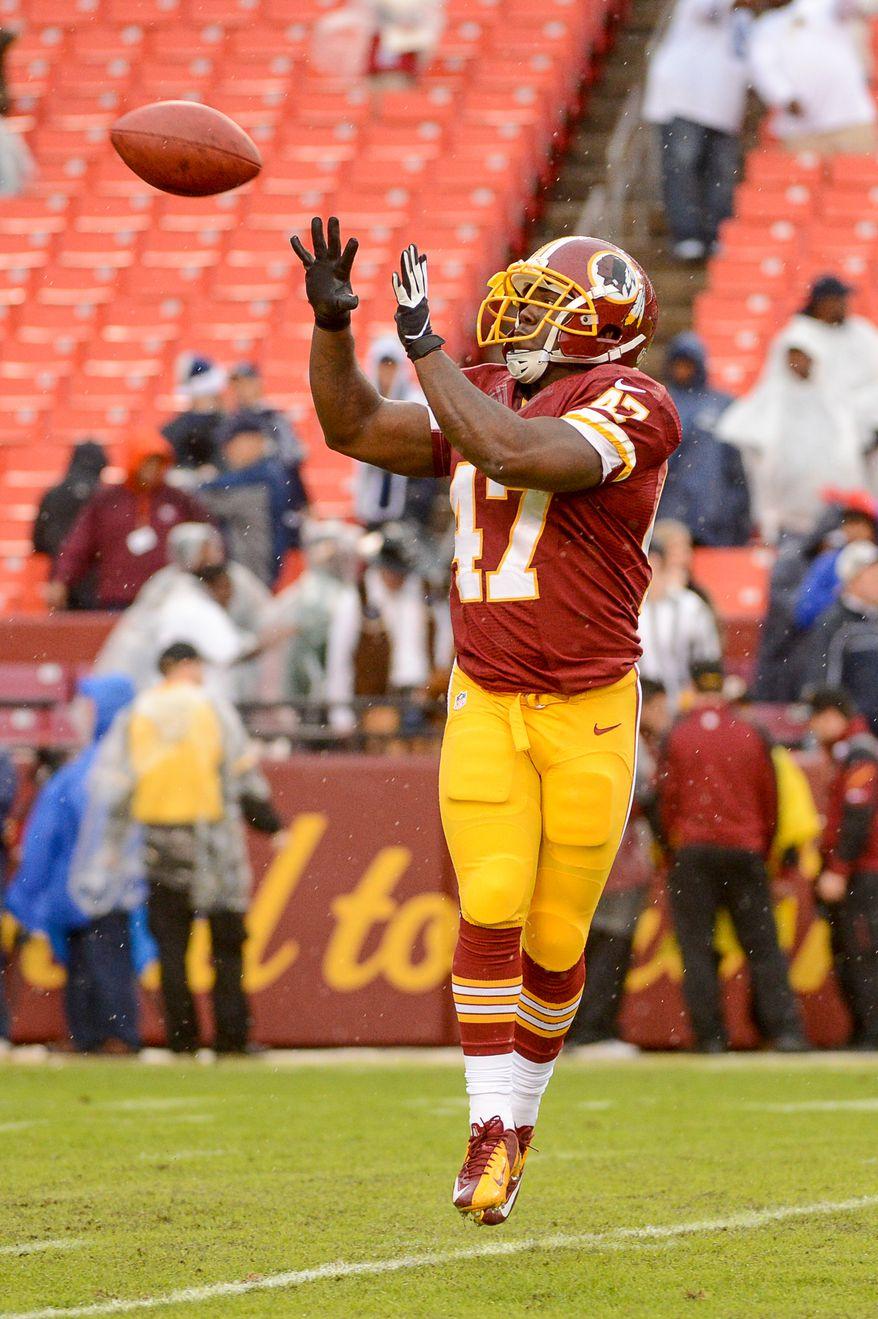 Washington Redskins running back Jawan Jamison (47) warms up with teammates before the Washington Redskins play the Dallas Cowboys at FedExField, Landover, Md., Sunday, December 22, 2013. (Andrew Harnik/The Washington Times)