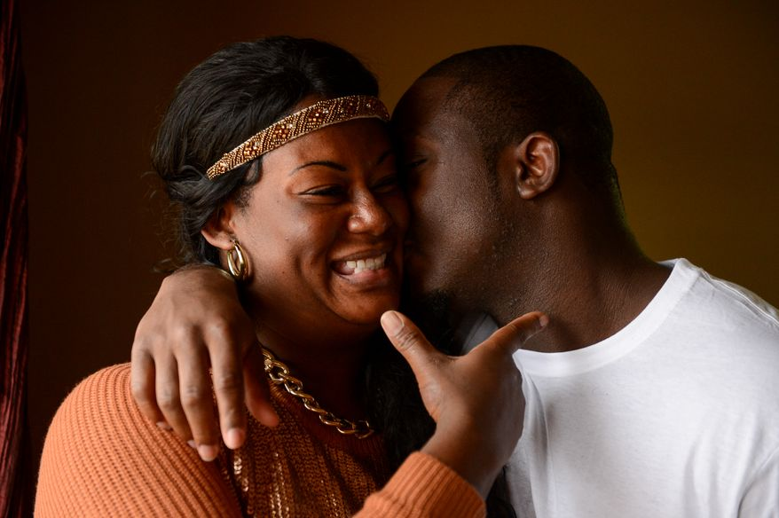 Washington Redskins running back Jawan Jamison and his mother Shanda Barnes-Davis pose for a portrait together his Jawan's home, Ashburn, Va., Monday, December 23, 2013. (Andrew Harnik/The Washington Times)