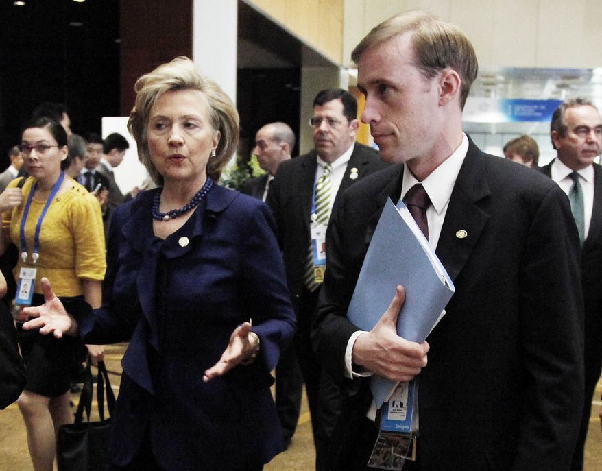 ** FILE ** This Nov. 11, 2009, file photo shows then-Secretary of State Hillary Rodham Clinton walking with a then-Deputy Chief of Staff Jake Sullivan in Singapore. Last summer, Sullivan was traveling with his boss, Hillary Rodham Clinton, when he suddenly disappeared during a stop in Paris. He showed up again a few days later, rejoining Clinton's traveling contingent in Mongolia. (AP Photo/Ng Han Guan, File)