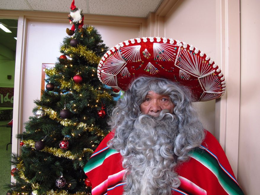 In this Wednesday, Dec. 18, 2013, photo, Julian Perez stands in his Pancho Claus suit in Lubbock, Texas. The retired 71-year-old has donned the Pancho Claus suit for 30 years to hand out gifts for low-income and at-risk children. (AP Photo/Betsy Blaney)