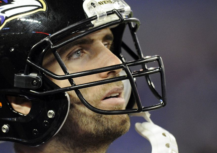 Baltimore Ravens quarterback Joe Flacco stands on the sideline in the second half of an NFL football game against the New England Patriots, Sunday, Dec. 22, 2013, in Baltimore. (AP Photo/Nick Wass)