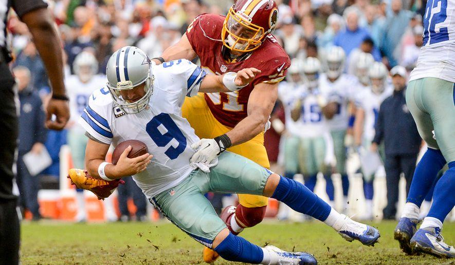 Washington Redskins outside linebacker Ryan Kerrigan (91) sacks Dallas Cowboys quarterback Tony Romo (9) in the third quarter as the Washington Redskins play the Dallas Cowboys at FedExField, Landover, Md., Sunday, December 22, 2013. (Andrew Harnik/The Washington Times)