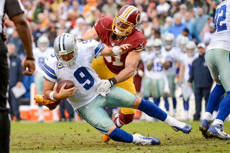 Washington Redskins outside linebacker Ryan Kerrigan (91) sacks Dallas Cowboys quarterback Tony Romo (9) in the third quarter as the Washington Redskins play the Dallas Cowboys at FedExField, Landover, Md., Sunday, December 22, 2013. (Andrew Harnik/The Washington Times)