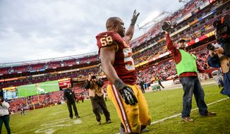 Washington Redskins inside linebacker London Fletcher (59) waves to fans as he leaves the field after the Washington Redskins lose to the Dallas Cowboys 24-23 at FedExField, Landover, Md., Sunday, December 22, 2013. (Andrew Harnik/The Washington Times)