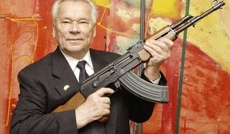 "FILE - In this July 26, 2002 file photo, Russian weapon designer Mikhail Kalashnikov presents his legendary assault rifle to the media while opening the exhibition ""Kalashnikov - legend and curse of a weapon"" at a weapons museum in Suhl, Germany. Mikhail Kalashnikov, whose work as a weapons designer for the Soviet Union is immortalized in the name of the world's most popular firearm, has died at the age of 94, Monday Dec. 23, 2013. (AP Photo/Jens Meyer, File)"