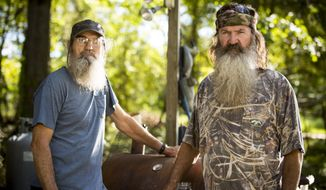 "** FILE ** This undated image released by A&E shows brothers Silas ""Uncle Si"" Robertson, left, and Phil Robertson from the popular series ""Duck Dynasty."" Phil Robertson was suspended last week for disparaging comments he made to GQ magazine about gay people. (AP Photo/A&E, Zach Dilgard)"