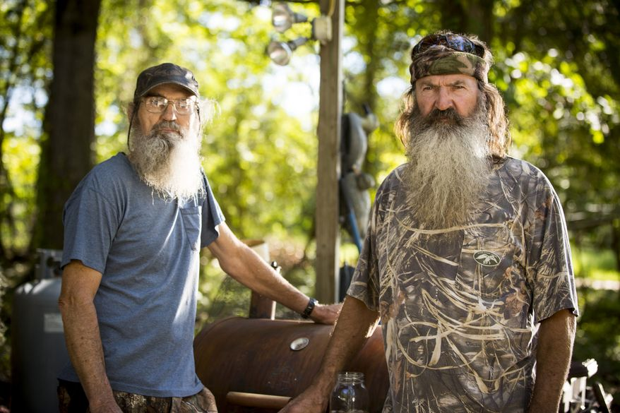 """** FILE ** This undated image released by A&E shows brothers Silas """"Uncle Si"""" Robertson, left, and Phil Robertson from the popular series """"Duck Dynasty."""" Phil Robertson was suspended last week for disparaging comments he made to GQ magazine about gay people. (AP Photo/A&E, Zach Dilgard)"""
