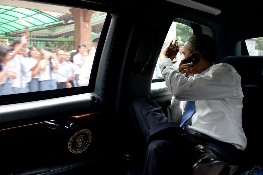 President Barack Obama waves to people along the motorcade route while traveling from the University of Indonesia to the airport in Jakarta, Indonesia, Nov. 10, 2010. (Official White House Photo by Pete Souza)