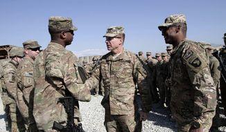 U.S. Maj. Gen. James C. McConville, center, visits troops in Jalalabad, base east of Kabul, Afghanistan, Tuesday, Dec. 24, 2013. (AP Photo/Rahmat Gul) ** FILE **
