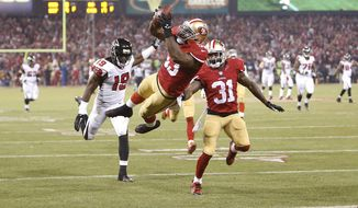 San Francisco 49ers linebacker NaVorro Bowman, center, dives into the end zone after returning an interception 89-yards for a touchdown during the fourth quarter of an NFL football game against the Atlanta Falcons in San Francisco, Monday, Dec. 23, 2013. The 49ers won 34-24. (AP Photo/San Jose Mercury News, Josie Lepe) MANDATORY CREDIT; MAGS OUT; NO SALES