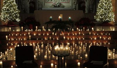 Dozens of candles adorn the alter during a Blue Christmas service at the Christ Church Cathedral, Monday, Dec. 23, 2013, in St. Louis. The solemn ceremony is for people who are sad or depressed during the holiday season. (AP Photo/Tom Gannam)