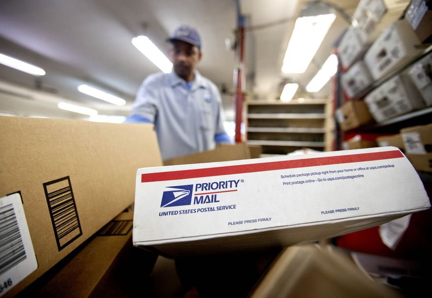 ** FILE ** This Feb. 7, 2013, file photo shows packages waiting to be sorted in a Post Office in Atlanta. (AP Photo/David Goldman, File)