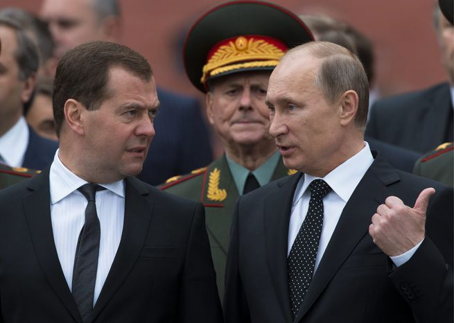 "ON THE OUTS: The ""Batman"" and ""Robin"" of Russia, Vladimir Putin (right) and Dmitry Medvedev, are no longer a team. After reassuming the presidency from Mr. Medvedev, Mr. Putin has sidelined his protege and spoken of him with condescension. Russians are disappointed that Mr. Medvedev failed to implement the changes he promised. (Associated Press)"