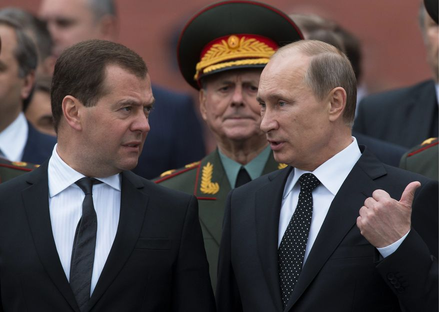 """ON THE OUTS: The """"Batman"""" and """"Robin"""" of Russia, Vladimir Putin (right) and Dmitry Medvedev, are no longer a team. After reassuming the presidency from Mr. Medvedev, Mr. Putin has sidelined his protege and spoken of him with condescension. Russians are disappointed that Mr. Medvedev failed to implement the changes he promised. (Associated Press)"""