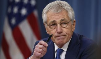 "Defense Secretary Chuck Hagel offended Beijing by calling its navy ""irresponsible"" after the near collision of a U.S. guided missile cruiser and a Chinese vessel Dec. 5. A Communist Party news outlet said Mr. Hagel ""shows U.S. hegemony addiction."" (associated press)"
