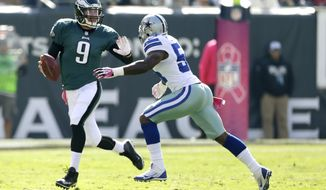 Philadelphia Eagles quarterback Nick Foles (9) runs with the ball with Dallas Cowboys outside linebacker Bruce Carter (54) in pursuit during the first half of an NFL football game, Sunday, Oct. 20, 2013, in Philadelphia. (AP Photo/Matt Rourke)