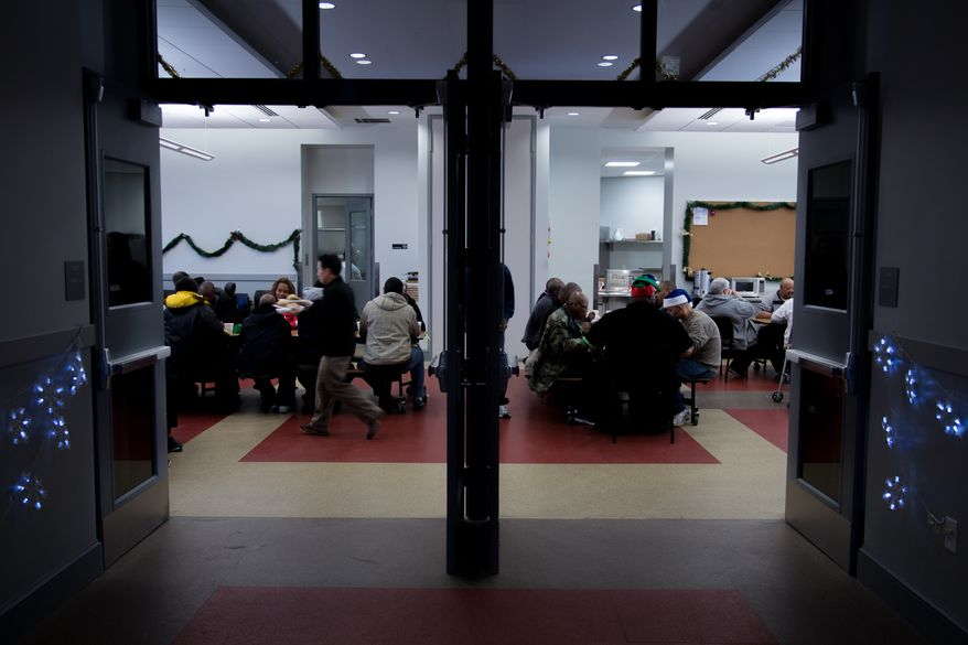 Homeless guests at the Central Union Mission are entertained by Christmas Carols and a hot holiday meal during the annual Christmas Day lunch, in Washington, DC., Wednesday, December 25, 2013.  (Andrew S Geraci/The Washington Times)