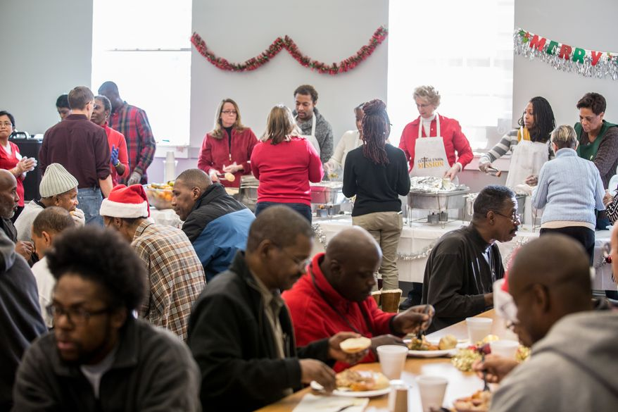 Homeless guests at the Central Union Mission are entertained by Christmas Carols and receive a hot holiday meal during the annual Christmas Day lunch, in Washington, DC., Wednesday, December 25, 2013.  (Andrew S Geraci/The Washington Times)