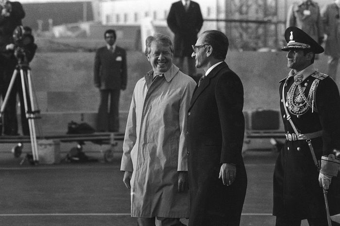 """President Carter and the Shah of Iran receive salutes after reviewing the honor guard during arrival ceremonies in 1977. Mr. Carter is the last U.S. president to have visited Iran. The Islamic republic now is unlikely to welcome the leader of the """"Great Satan."""" (Associated Press)"""
